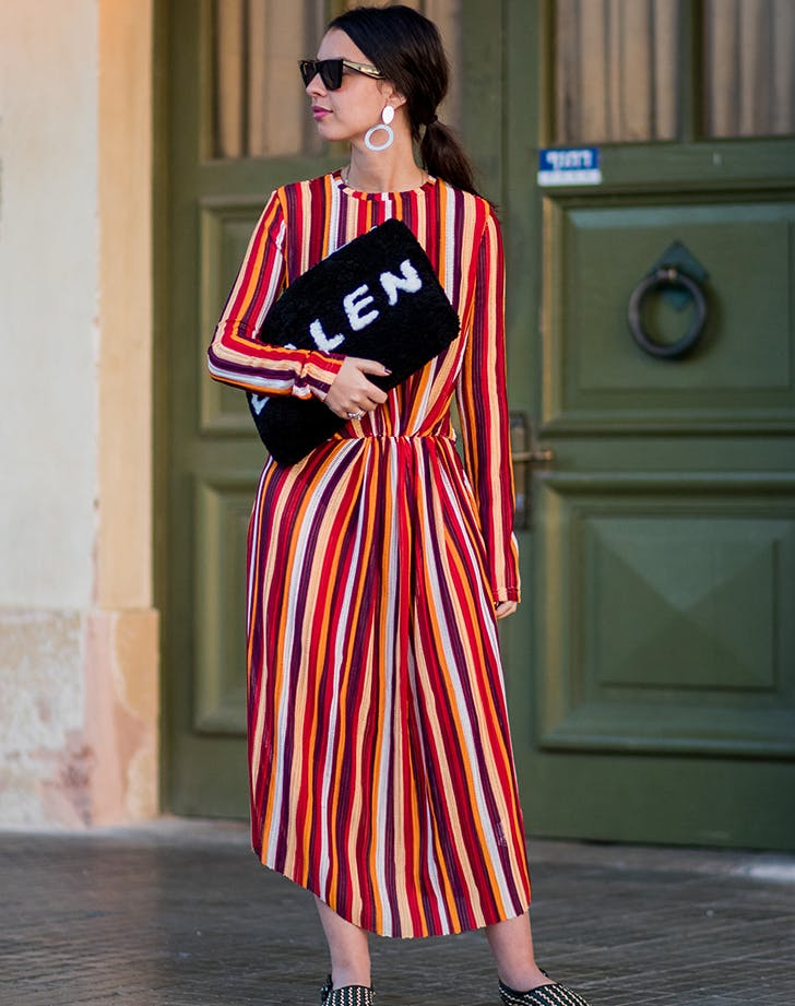 woman wearing bold vertical stripes