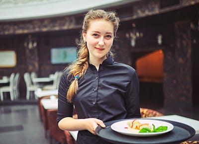 young watiress carying tray of salad 290