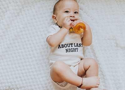 Cute baby in gender netural onesie 400