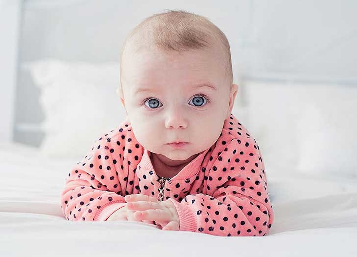 Cute baby on the white bed