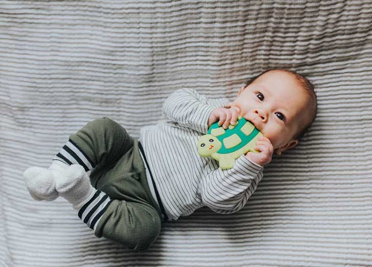 Cute baby with teething toy