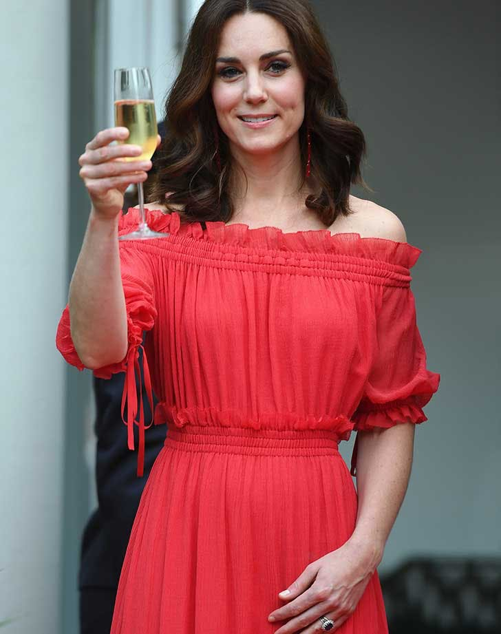 Kate Middleton toasting with glass of champagne