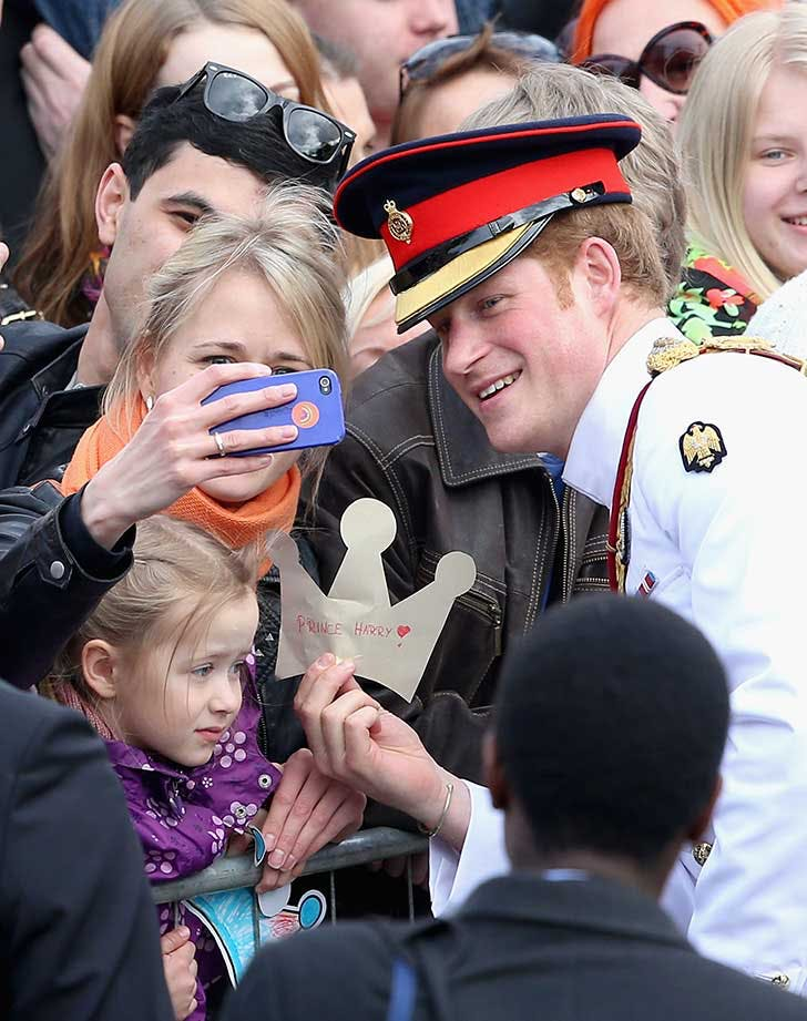 Prince Harry taking a selfie with the public