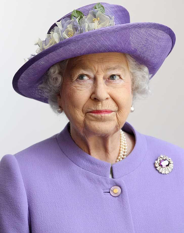 Queen Elizabeth in purple hat
