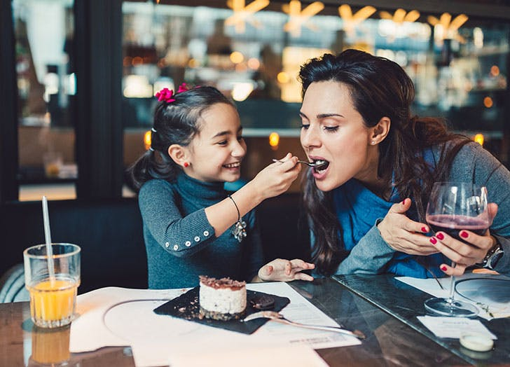 Woman and child enjoying birthday dinner at restaurant