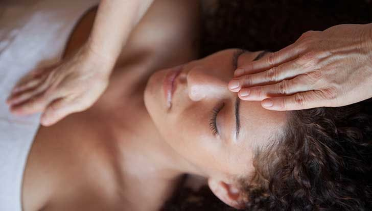 Woman doing reiki energy work