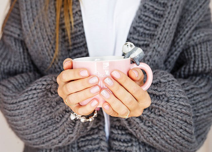 Woman with keto flu holding mug of broth