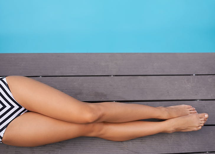 bare legs on a dock