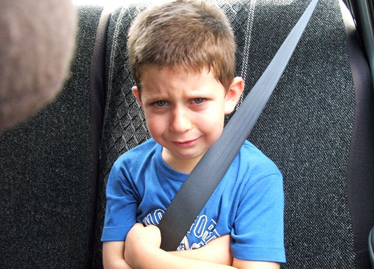 boy crying in the car