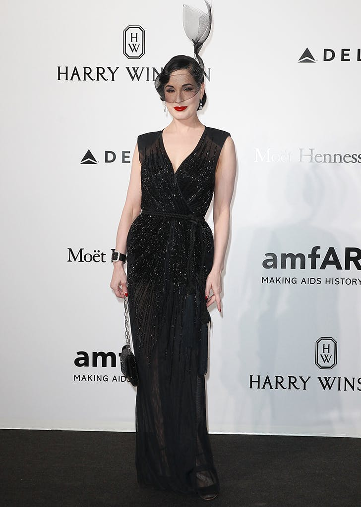 dita von teese wearing a black gown and headpiece