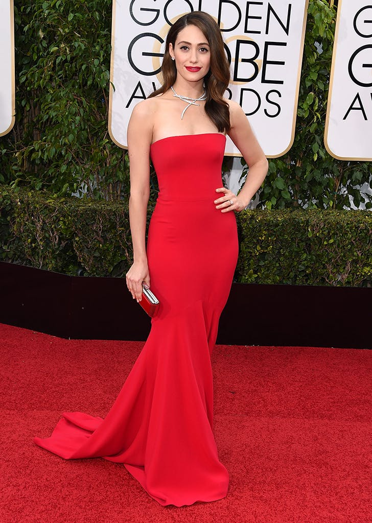 emmy rossum wearing a red gown