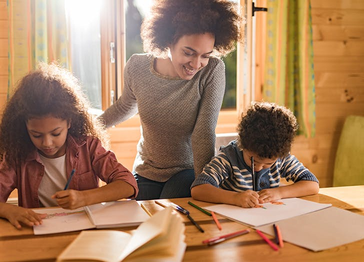 family doing homework together