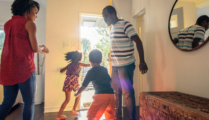 family running out the door of their brand new house to play