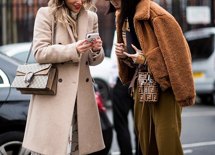 fashionable women looking at phone