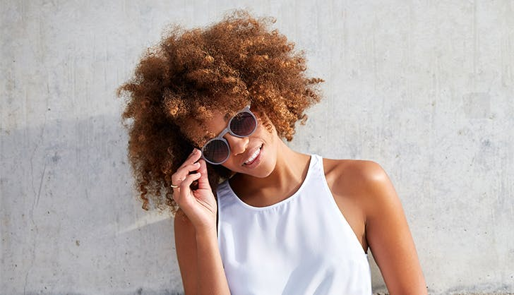 girl with natural curly hair wearing sunglasses