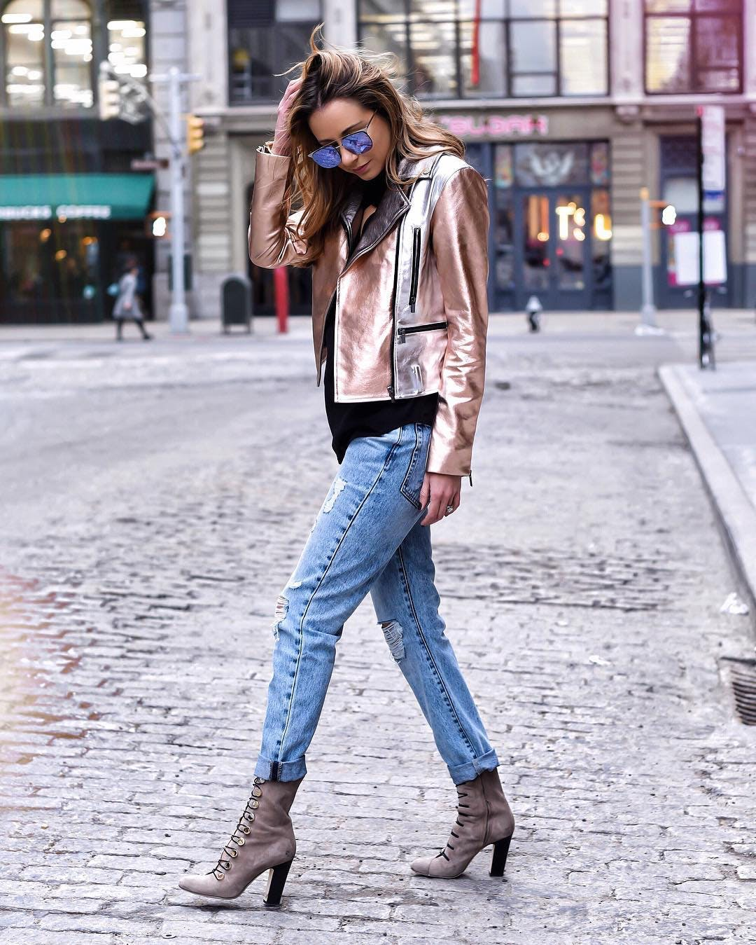 marni harvey wearing a metallic moto jacket