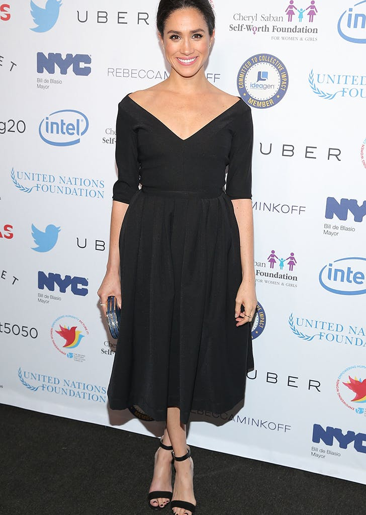 meghan markle wearing a black midi dress