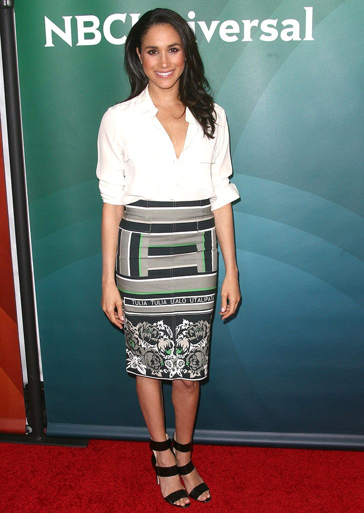 meghan markle wearing a button down and skirt