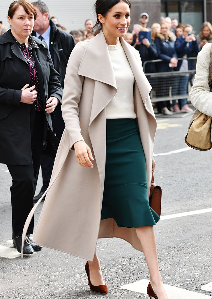 meghan markle wearing a pencil skirt and wrap coat