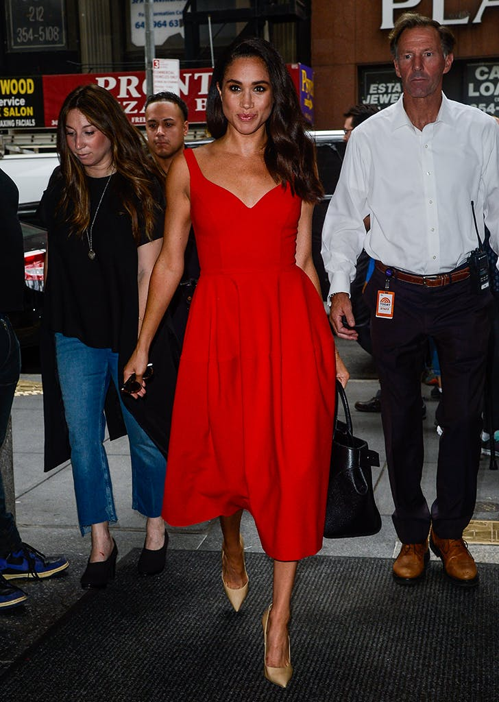 meghan markle wearing a red midi dress