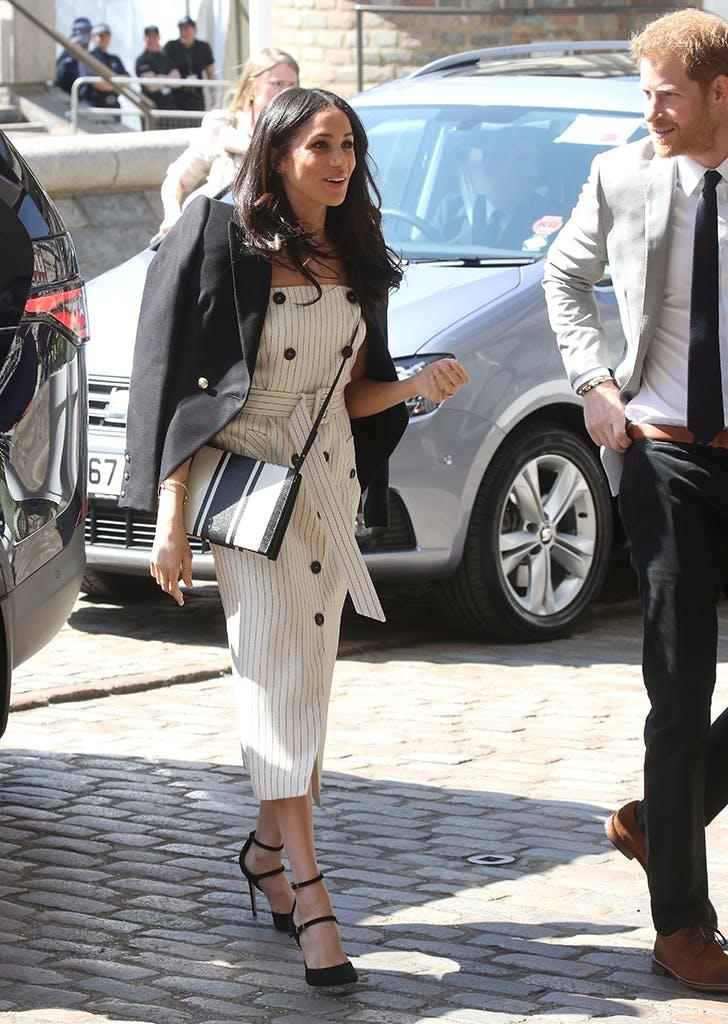 meghan markle wearing a striped dress and blazer