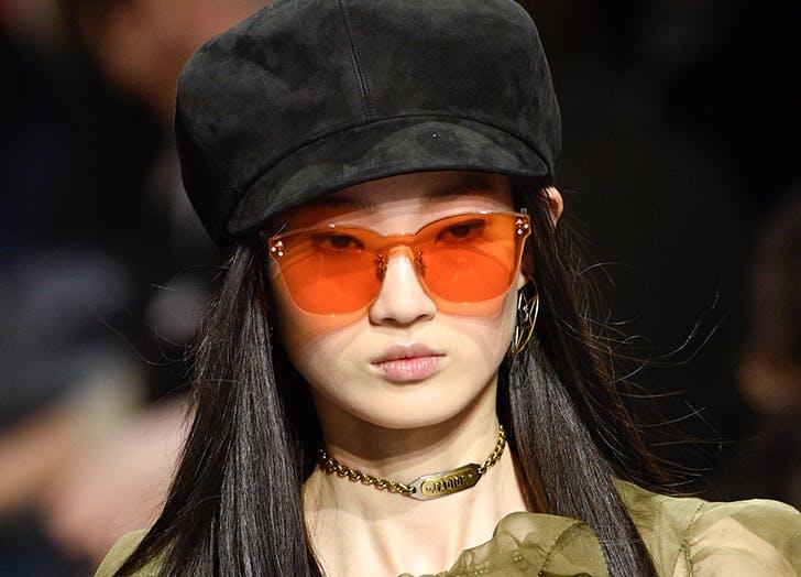 model wearing colored translucent sunglasses