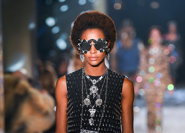 model wearing embellished sunglasses