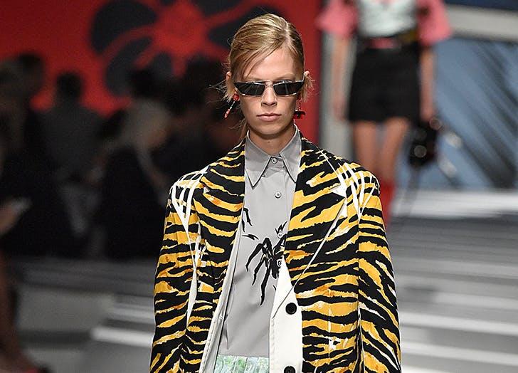 model wearing tiny sunglasses