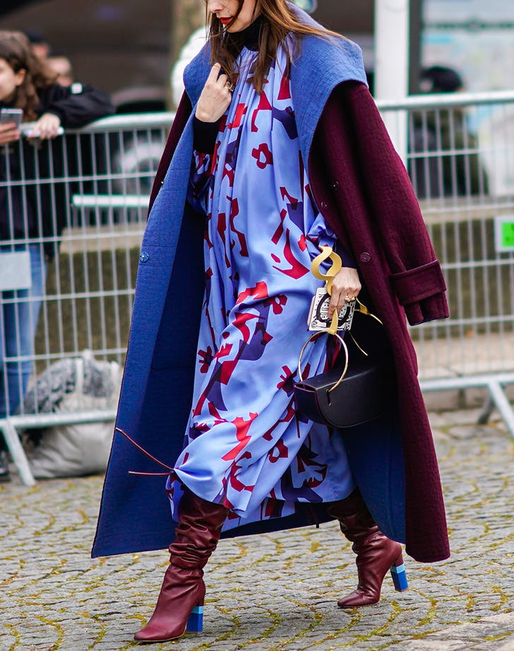 pregnant woman wearing periwinkle blue and burgundy