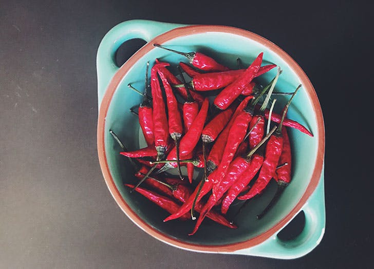 red hot chilli peppers in a strainer