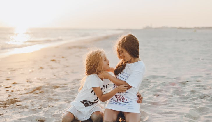 sisters hanging out at the beach together