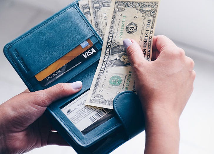 taking money out of wallet
