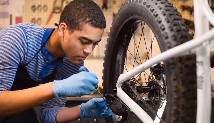 teenage boy working in a boke repair shop