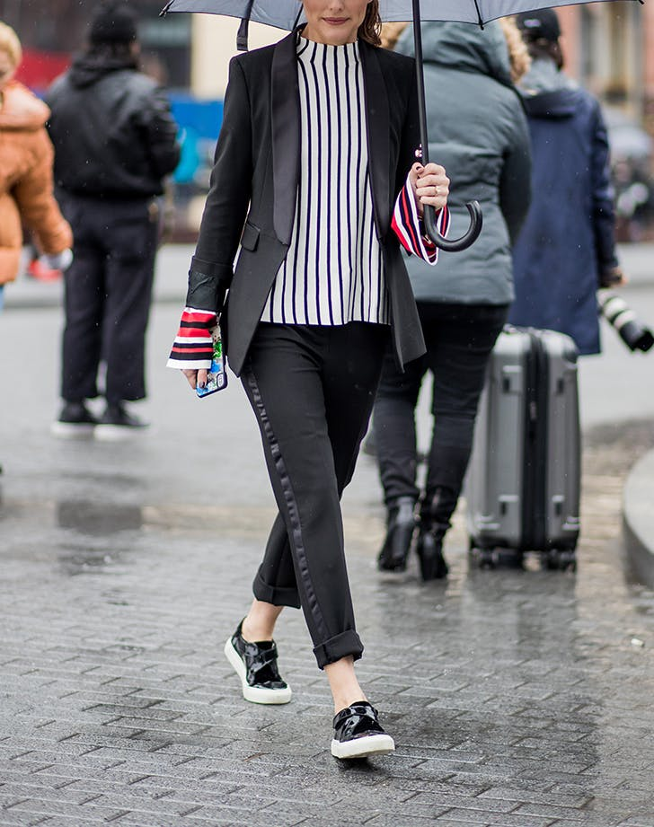 woman wearing a striped shirt with black pants and a blazer