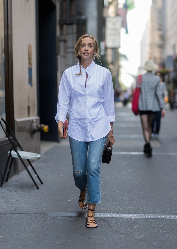 woman wearing a white button down and jeans
