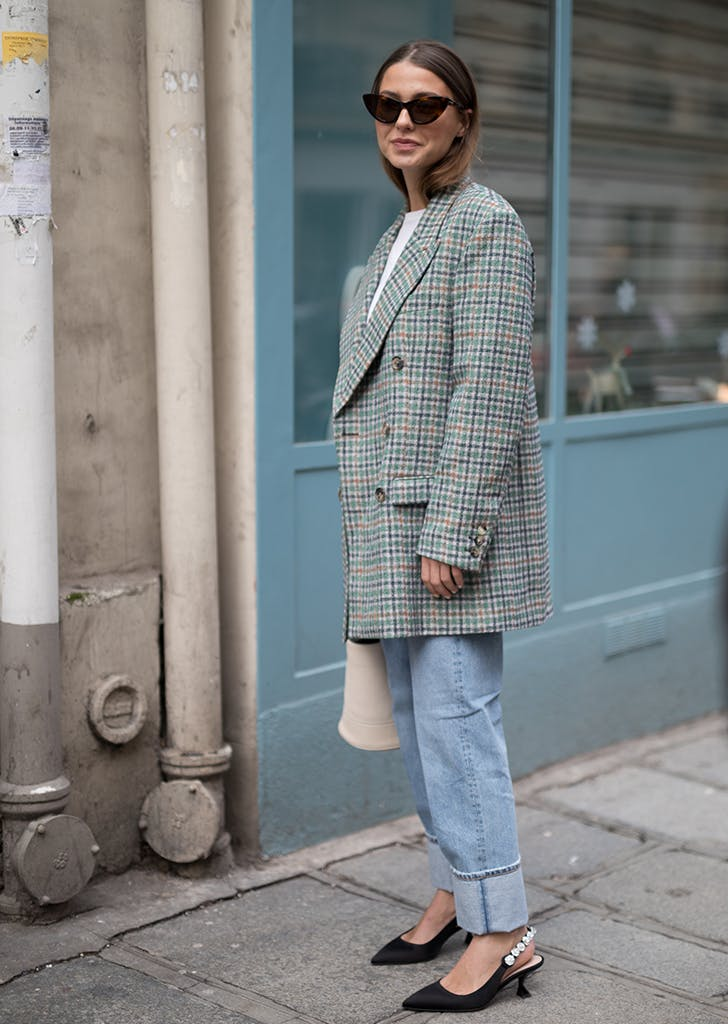 woman wearing an oversize blazer and kitten heels
