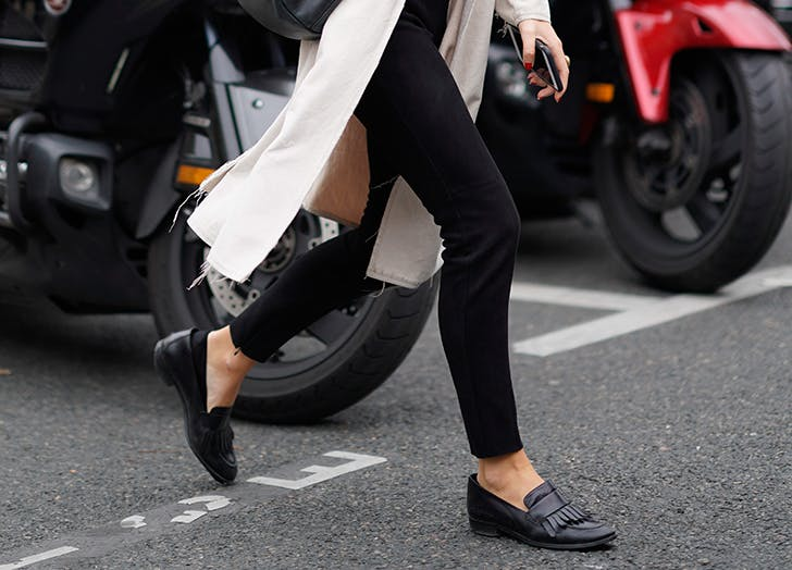 woman wearing black pants and loafers