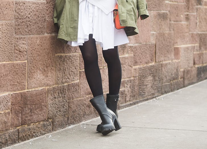woman wearing heeled rain booties