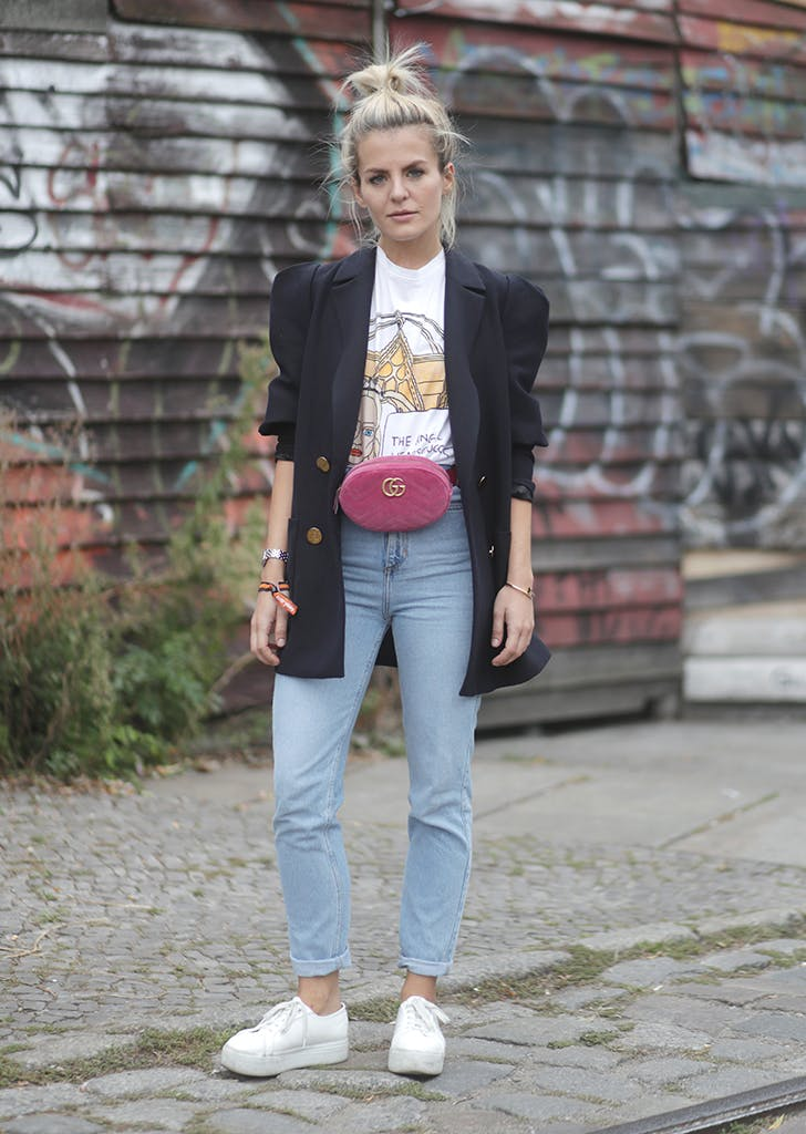 woman wearing jeans tshirt and belt bag