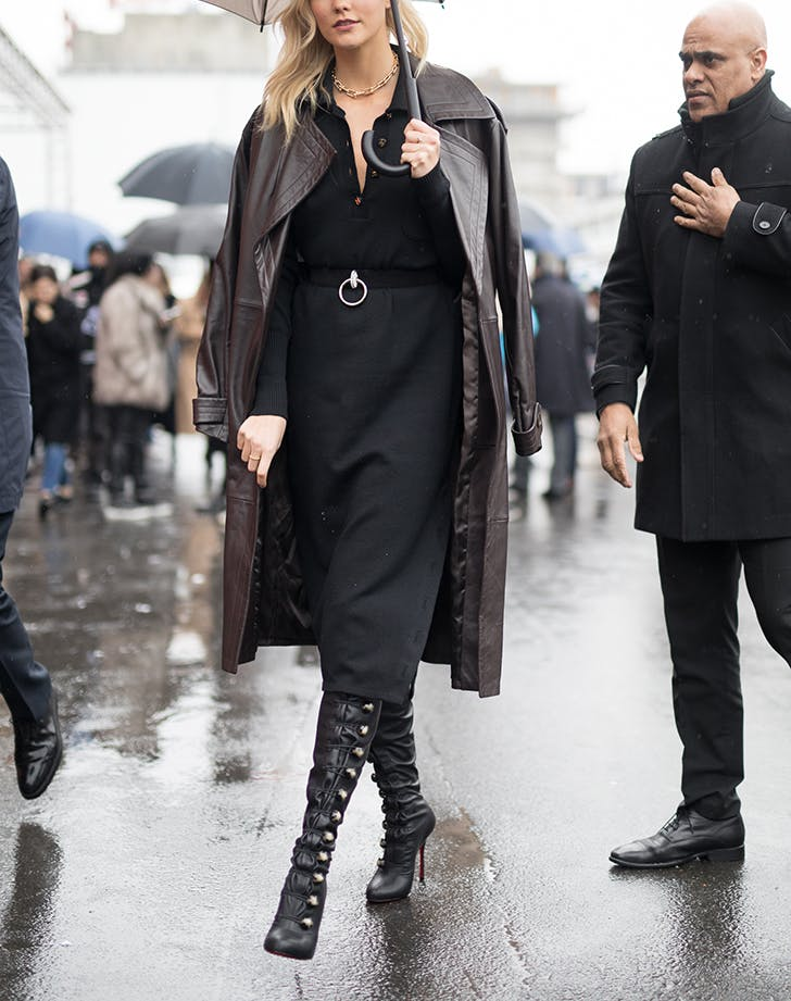 woman wearing midi skirt jacket and tall boots