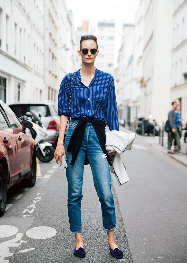 woman wearing striped shirt jeans and loafers