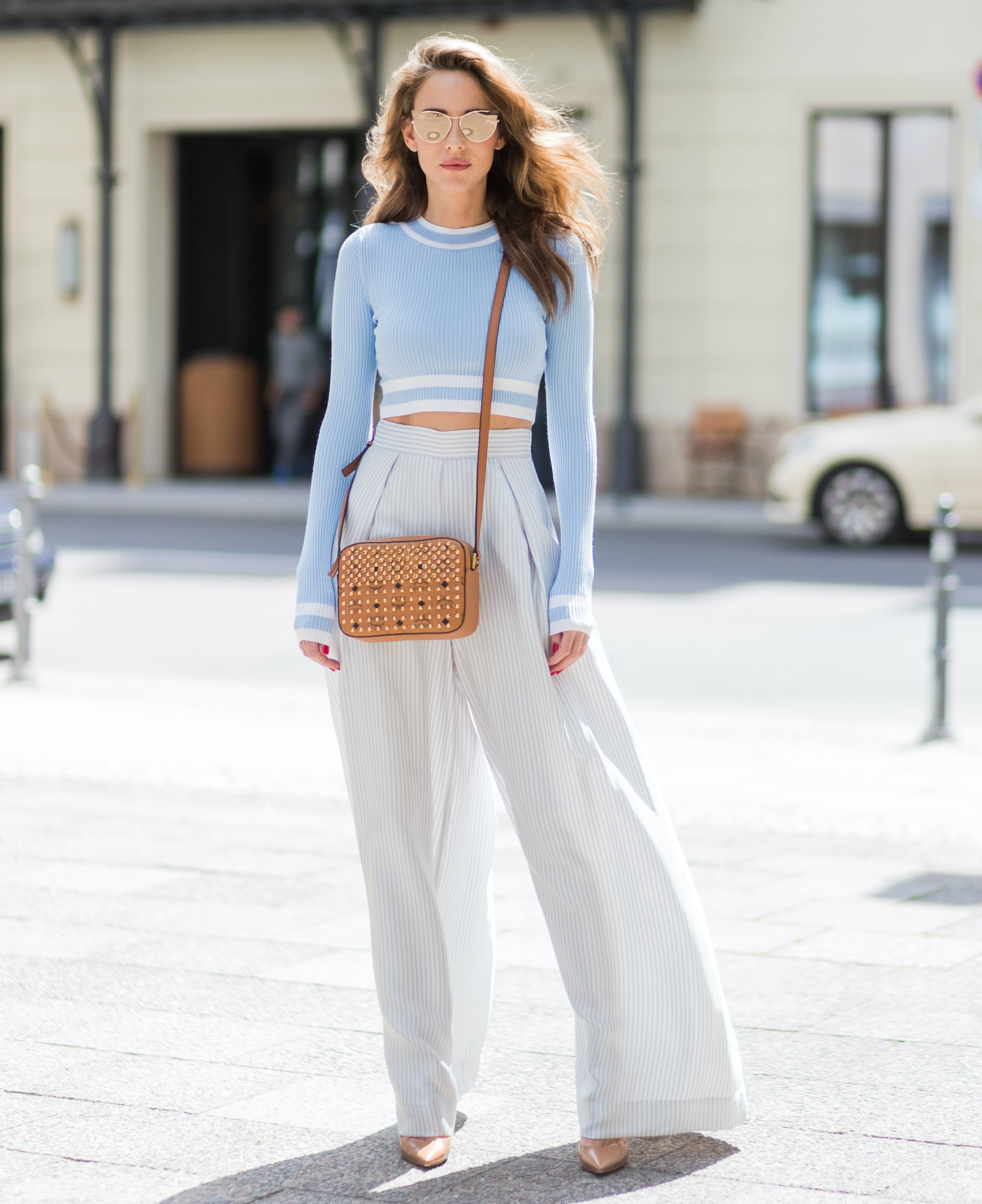 woman wearing a cropped sweater and high waisted pants
