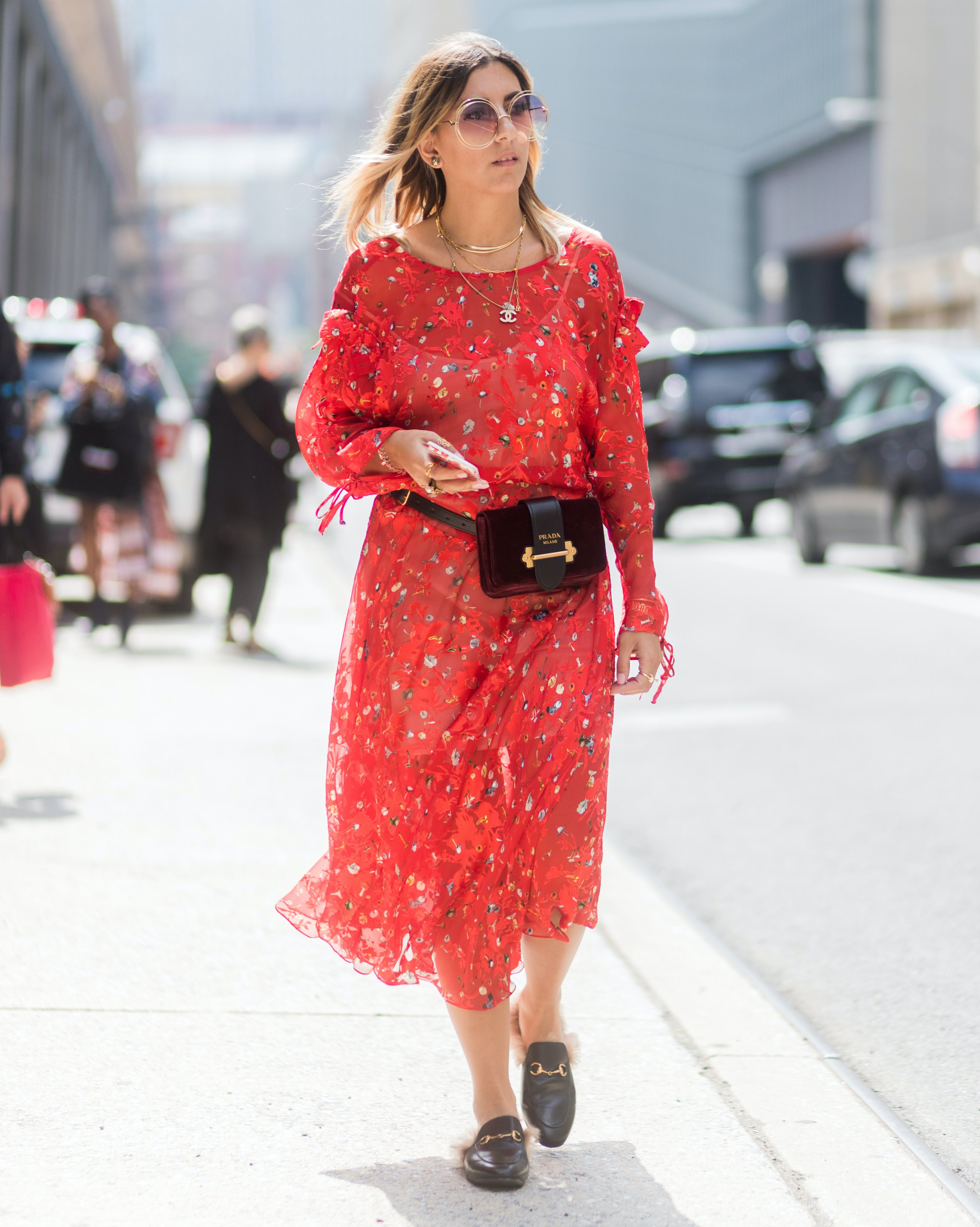 woman wearing a fanny pack over a floral dress