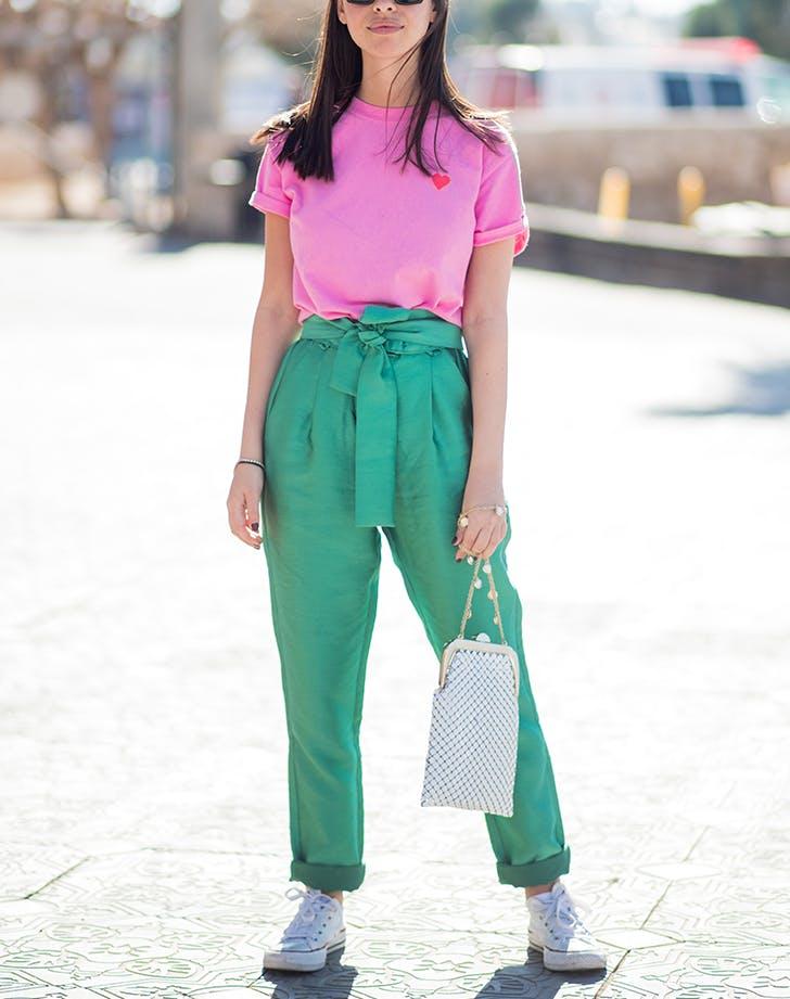 woman wearing a hot pink t shirt and green pants