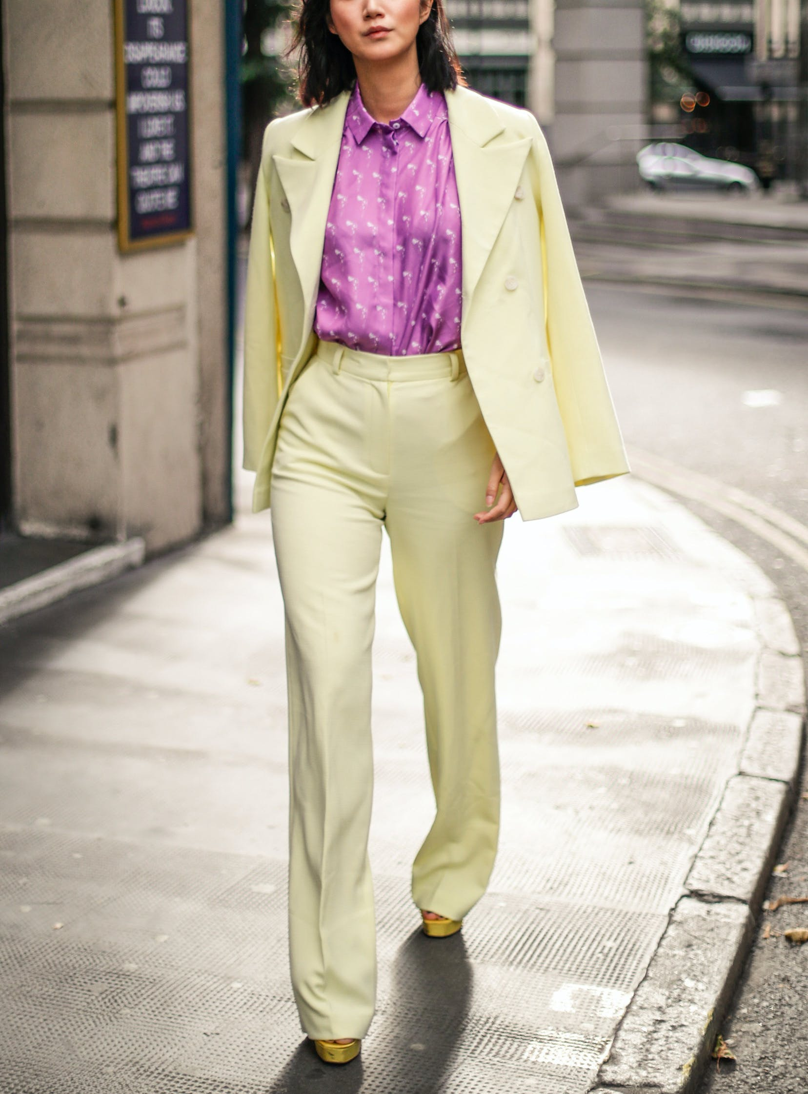 woman wearing a yellow sut with a purple blouse