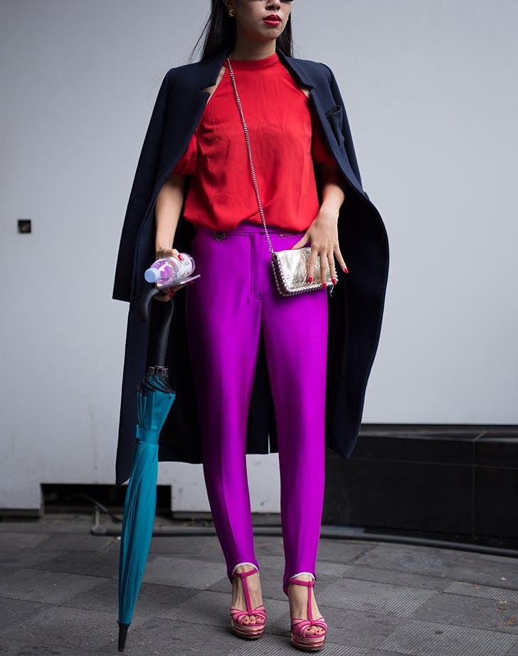 woman wearing bright red and ultra violet