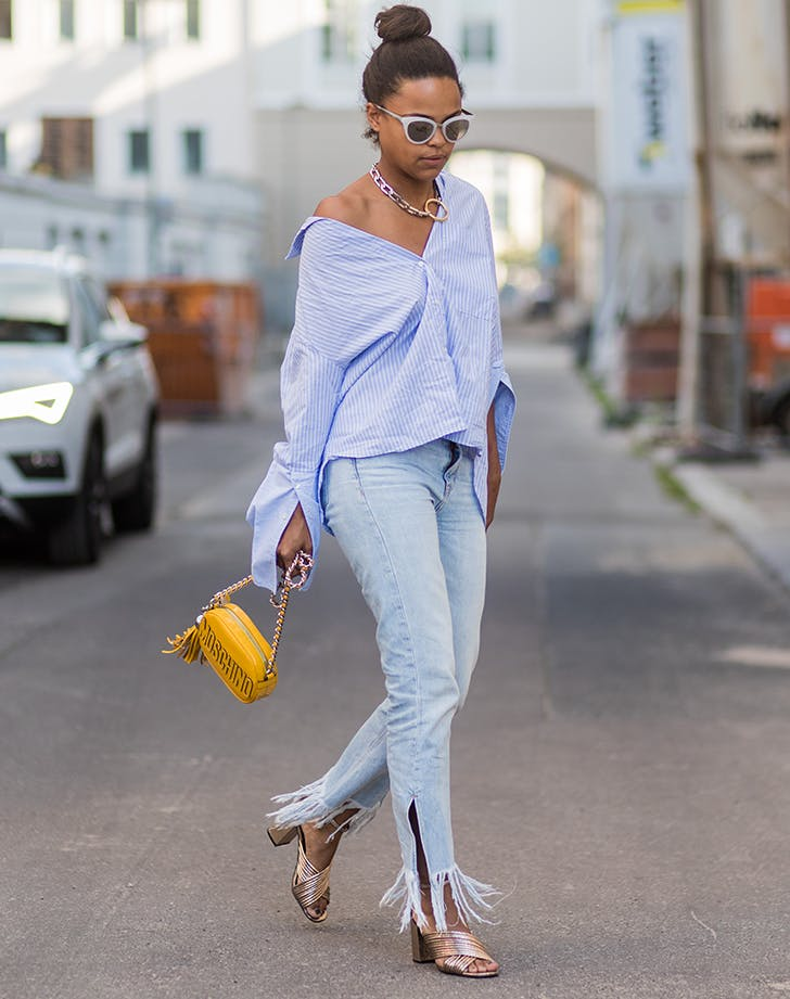 woman wearing fringed jeans