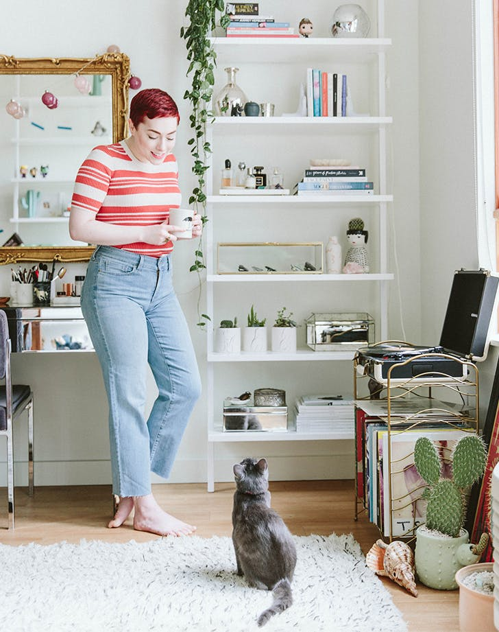 woman wearing jeans at home with cat