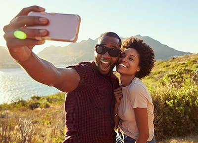 young couple posing for a selfie 400