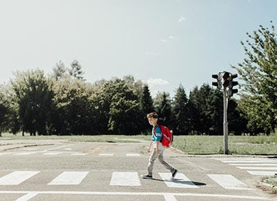 Boy crossing road to school free range parenting activity 400